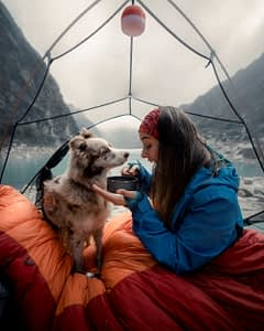 Woman and dog camping outdoors